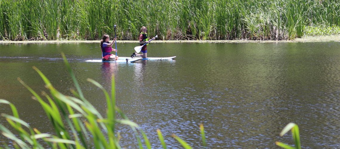 Youth paddleboarding on Granite Basin Lake